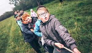 team-of-kids-playing-tug-of-war